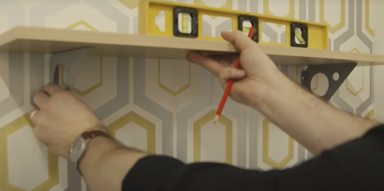 Placing the shelf on top of the brackets