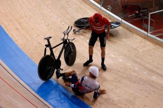 Denmarks Frederik Rodenberg Madsen reacts after crashing with Great Britains Charlie Tanfield during the first round heats of the mens track cycling team pursuit during the Tokyo 2020 Olympic Games