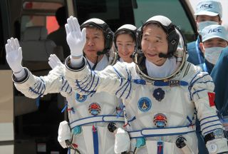 China's Shenzhou 9 Crew with Mission Patches