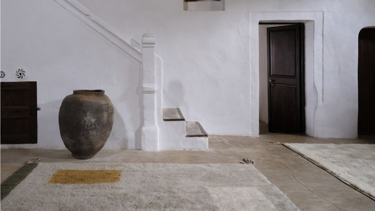 Athena Calderone designed rug in a hallway