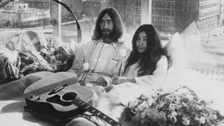 John Lennon and Yoko Ono mid-'bed in' in Amsterdam