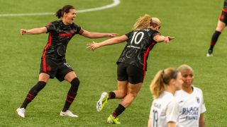 Portland Thorns celebrate LIndsey Horan's (10) goal during the NWSL Challenge Cup match between the OL Reign and the Portland Thorns on April 21, 2021, at Providence Park in Portland, Ore.