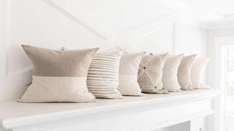 A series of cushions lined up against a wall