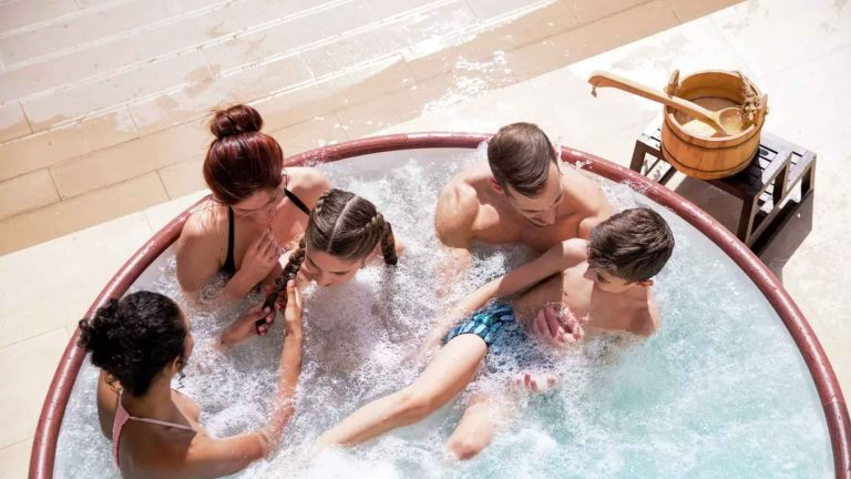 Best hot tubs: Lay-Z-Spa Helsinki 7 Person AirJet Hot Tub with family inside