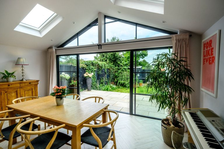 External sliding doors out onto patio from open dining room spac