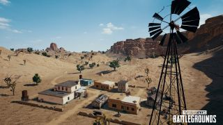 An image of a small cluster of buildings in PUBG s new desert map