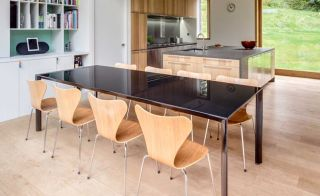 Open plan kitchen diner with large window