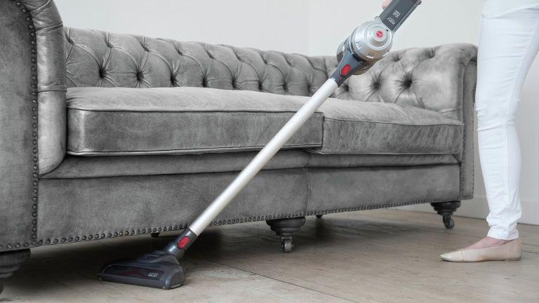 Hoover vacuum cleaner under sofa