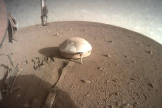 NASA's InSight Mars lander snapped this image of its seismometer suite, which is protected by a wind and thermal shield, on July 20, 2021.