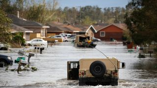 A National Guard vehicle drives through floodwater left behind by Hurricane Ida in LaPlace, Louisiana, U.S., on Monday, Aug. 30, 2021.