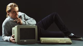 Remi Gallego from Algorithm poses with an old Atari system