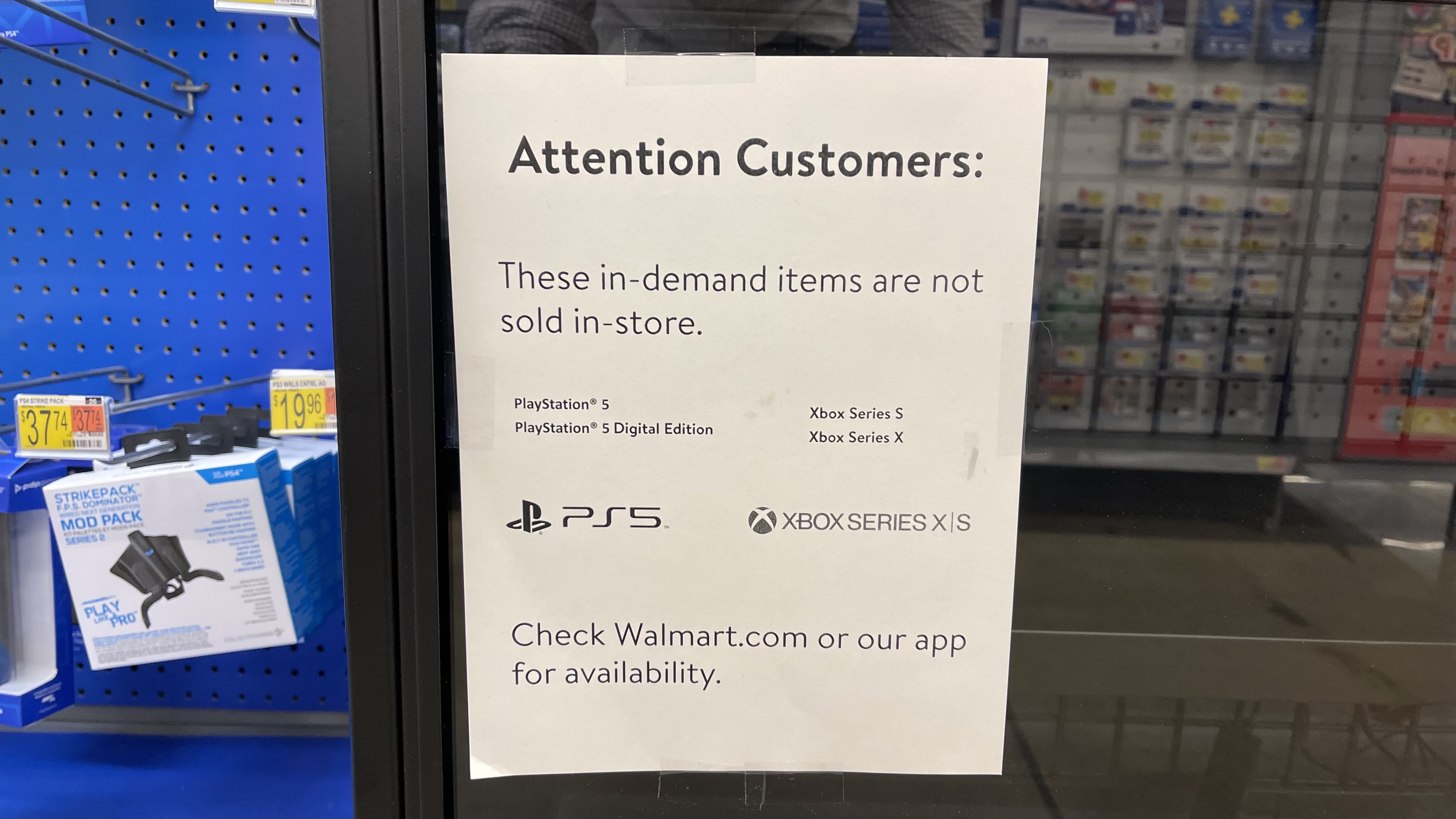 A printed sign at Walmart that tells customers PS5 and Xbox Series X are out of stock.