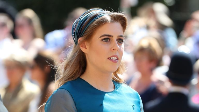 Princess Beatrice arrives at St George's Chapel at Windsor Castle before the wedding of Prince Harry to Meghan Markle on May 19, 2018 in Windsor, England