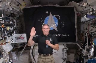 Col. Michael Hopkins, a NASA astronaut, recites the U.S. Space Force oath of enlistment while on the International Space Station on Friday, Dec. 18, 2020. Hopkins voluntarily transferred to the Space Force after 27 years serving in the Air Force.