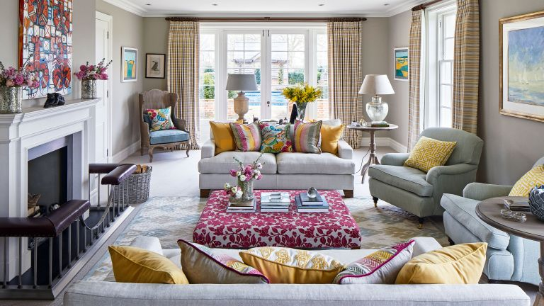 Living room sofa ideas with colorful upholstery and grey walls