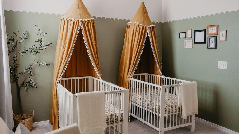 Twin nursery ideas by Taylor Follett with rust orange canopies
