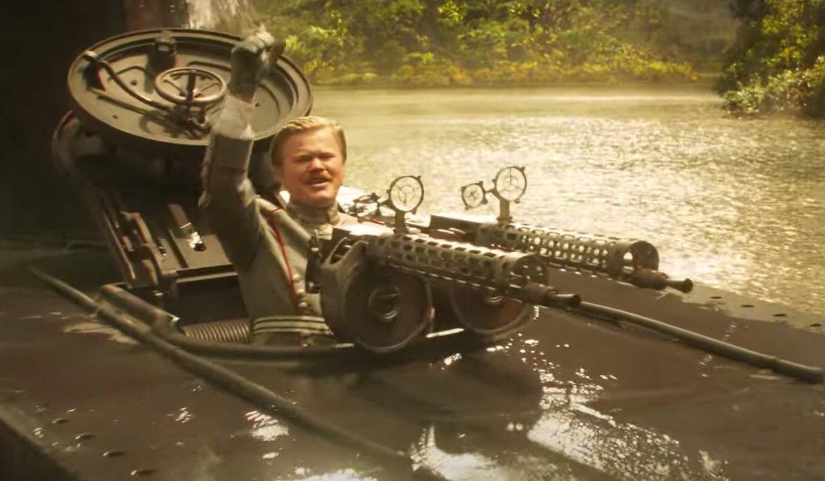 Jesse Plemons looks cheerful behind his machine gun in Jungle Cruise.