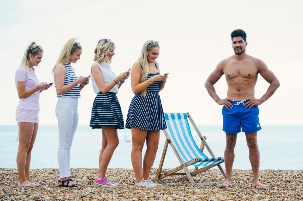 Louis Smith flexes his pecs on Brighton Beach