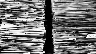 A close up of two stacks of paper.files.