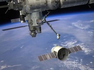 SpaceX Dragon cargo ship approaching the International Space Station in this artist's illustration.