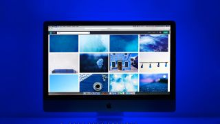 mac computer open on web browser with blue lighting