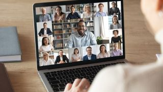 man on video call with colleagues