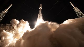 "A United Launch Alliance (ULA) Atlas V rocket takes off on an Air Force mission on Aug. 8, 2019. SpaceX and ULA will share the job of carrying ""national security"" cargo for the military going forward, as the Pentagon rushes to retire the Atlas V and its Russian-made rocket engines."