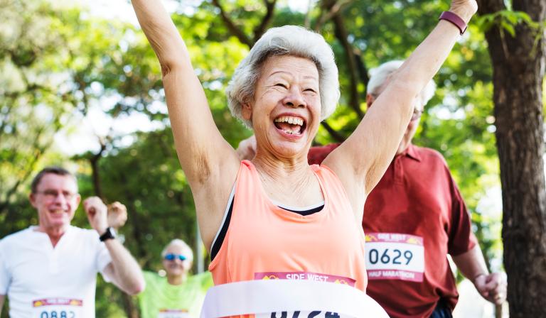 Senior woman finishing a half-marathon