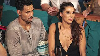 Bachelor in Paradise Becca Kufrin sits by Thomas Jacobs
