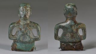 Two views of the restored copper statue show its fashionable hairstyle.