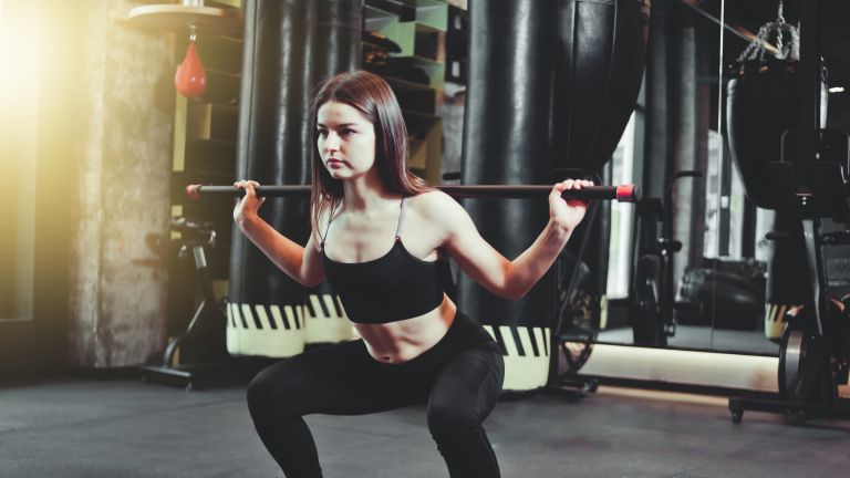 Woman squat with bar