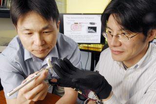 Professor Minoru Shinohara tests vibrating glove.