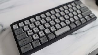 A Filco Majestouch MINILA-R gaming keyboard on a marble effect desk