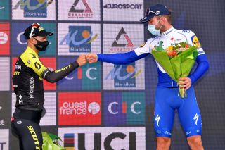 PLOUAY FRANCE AUGUST 25 Podium Luka Mezgec of Slovenia and Team Mitchelton Scott Florian Senechal of France and Team Deceuninck QuickStep Celebration Flowers Mask Covid safety measures during the 84th Bretagne Classic OuestFrance 2020 a 2478km race from Plouay to Plouay GrandPrixPlouay GPPlouay on August 25 2020 in Plouay France Photo by Luc ClaessenGetty Images