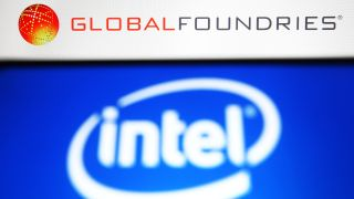 In this photo illustration, Intel logo is seen on a smartphone screen and GlobalFoundries (GF) logo of a semiconductor manufacturing company in the background.
