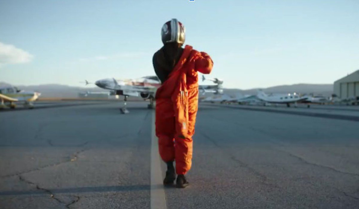 Star Wars: Rogue Squadron Patty Jenkins walks towards an X-Wing, putting on a flight suit