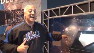 Former NASA astronaut Mike Massimino cheers on the Mets for Game 1 of the 2015 World Series at the Intrepid Sea, Air & Space Museum in New York City, where a Mets home plate that he took into space is on display.