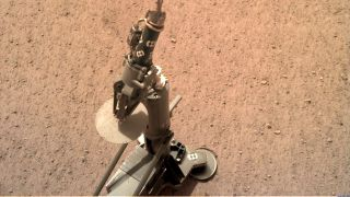 The InSight lander's heat probe, as deployed on the surface of Mars and photographed on Feb. 12, 2019.