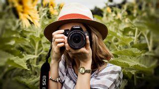 Woman in hat taking photo