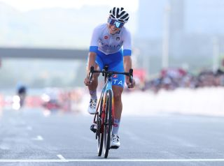 OYAMA JAPAN JULY 25 Elisa Longo Borghini of Team Italy celebrates winning the bronze medal on arrival on day two of the Tokyo 2020 Olympic Games at Fuji International Speedway on July 25 2021 in Oyama Shizuoka Japan Photo by Michael SteeleGetty Images