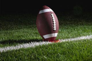 A football in a tee