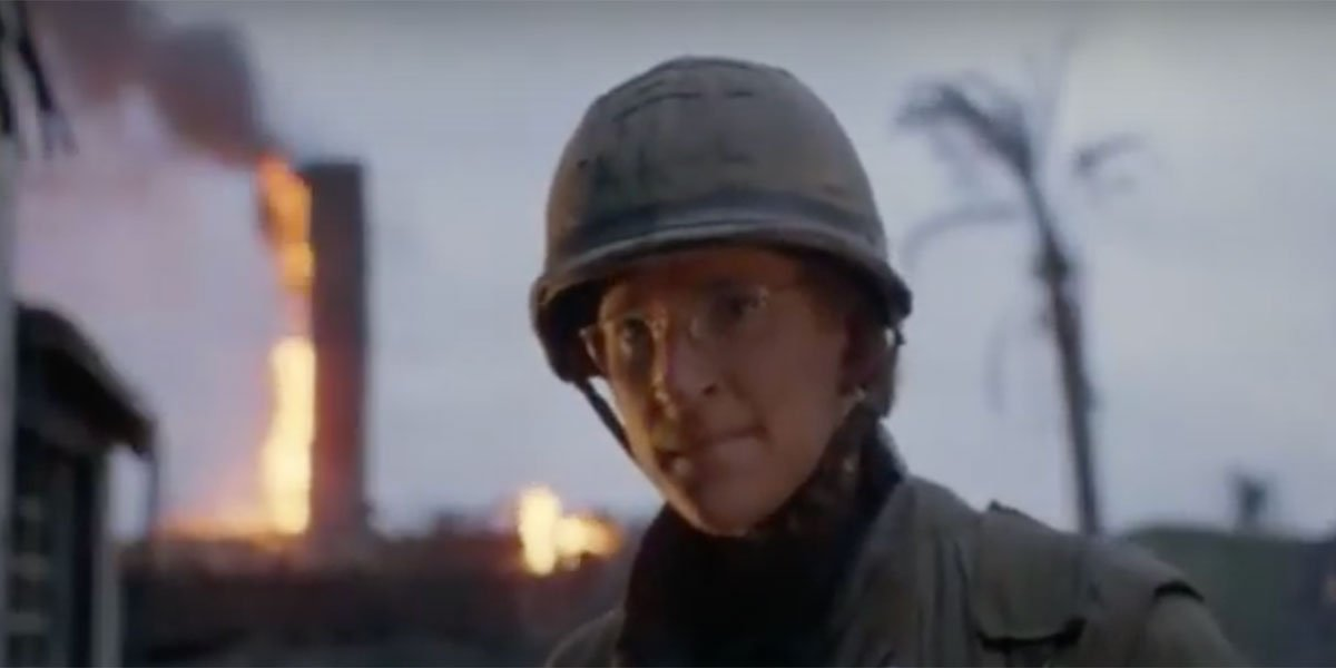 Matthew Modine looking intently with an explosion behind him in Full Metal Jacket.