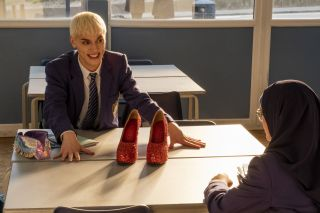Everybody's Talking About Jamie: Jamie (Max Harwood) proudly displays his brand new red high heels on the table at school