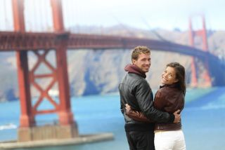 Young couple at Golden Gate Bridge.