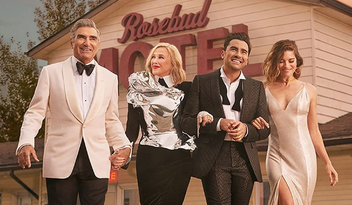 Schitt's Creek the Rose family dressed up in front of the motel