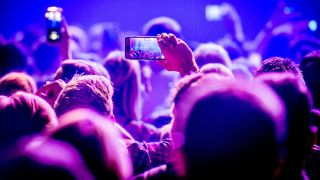 Fans filming and taking snaps at gigs has become commonplace