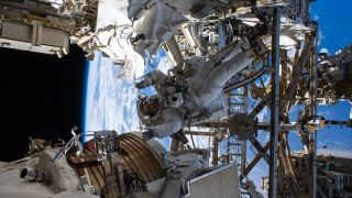 NASA astronaut Andrew Morgan works on the Alpha Magnetic Spectrometer during a spacewalk at the International Space Station.