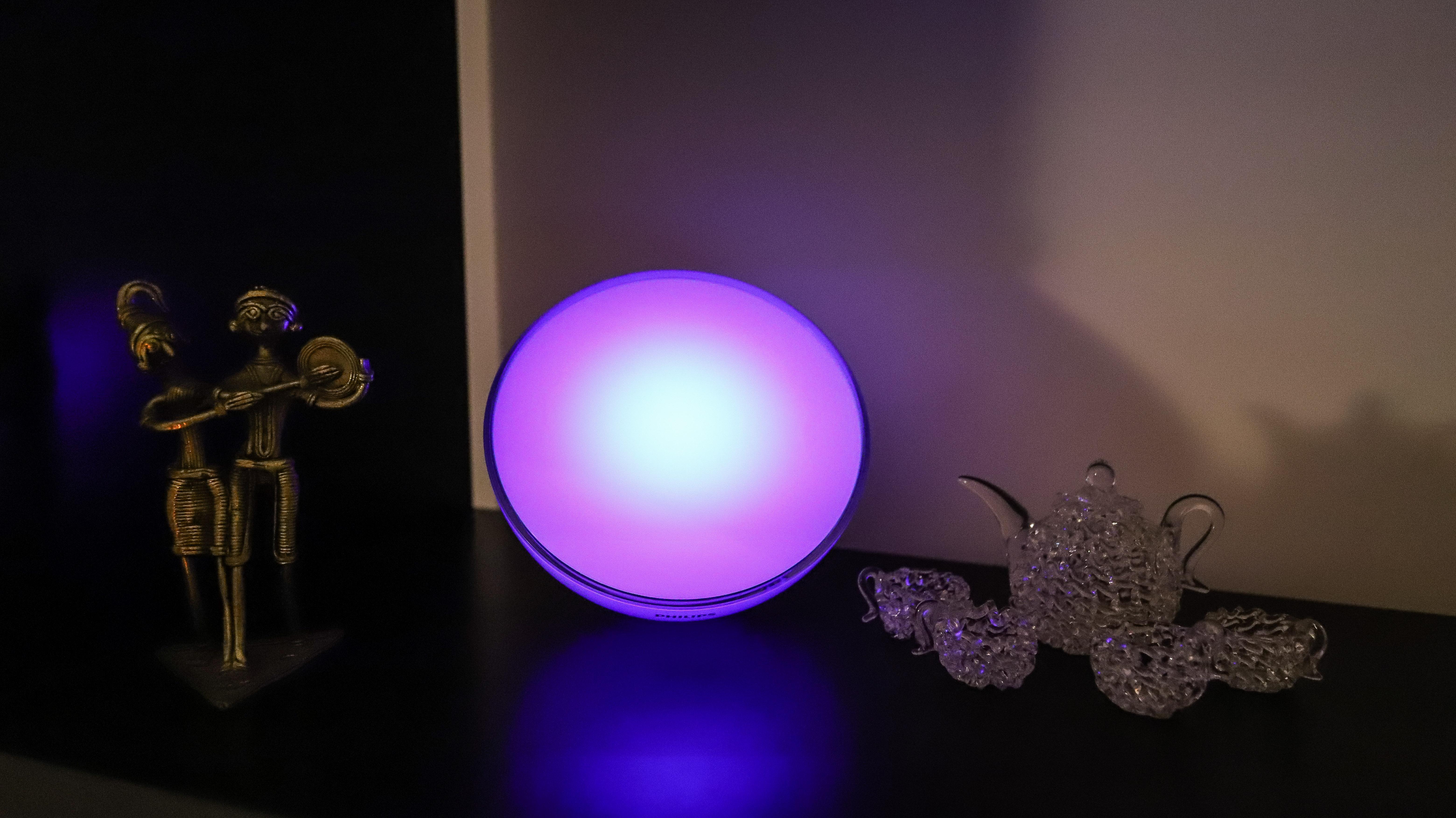 Philips Hue Go 2 with purple light on a shelf