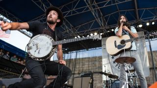 Scott and Seth Avett on stage at the Newport Folk Festival, July 2013