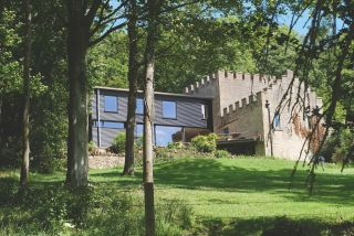 Piers taylor's renovation of a folly with a modern extension